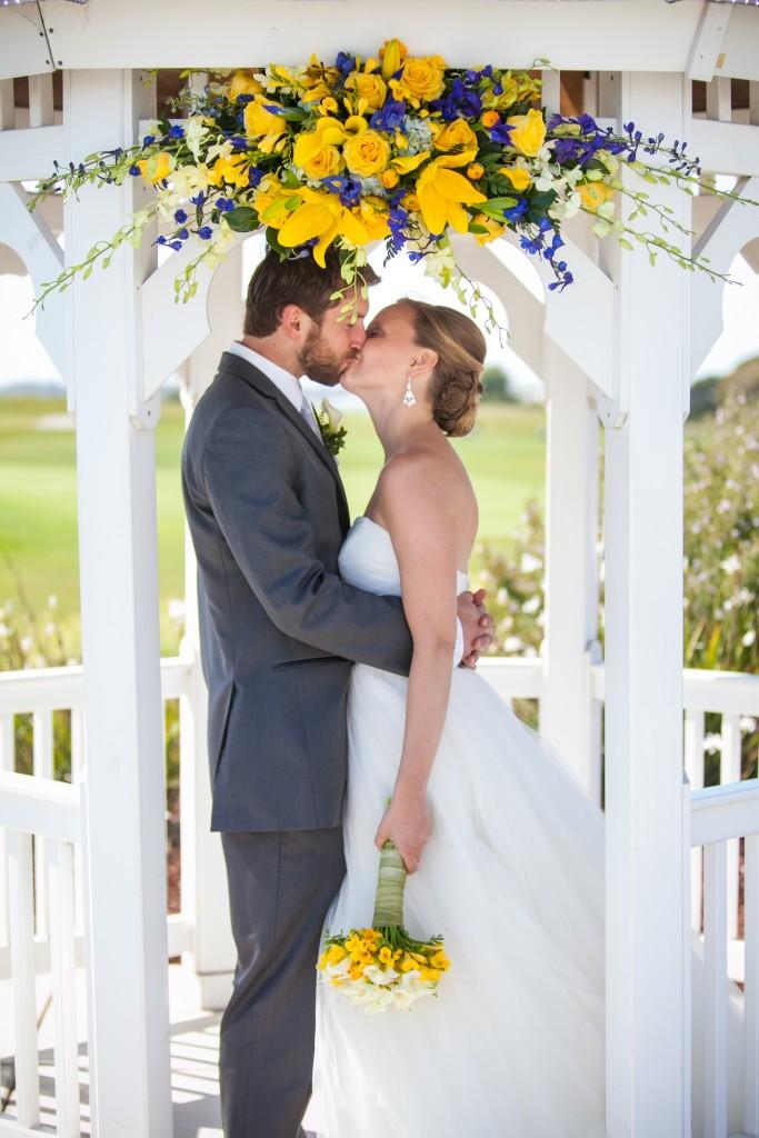 yellow wedding color scheme ceremony arch