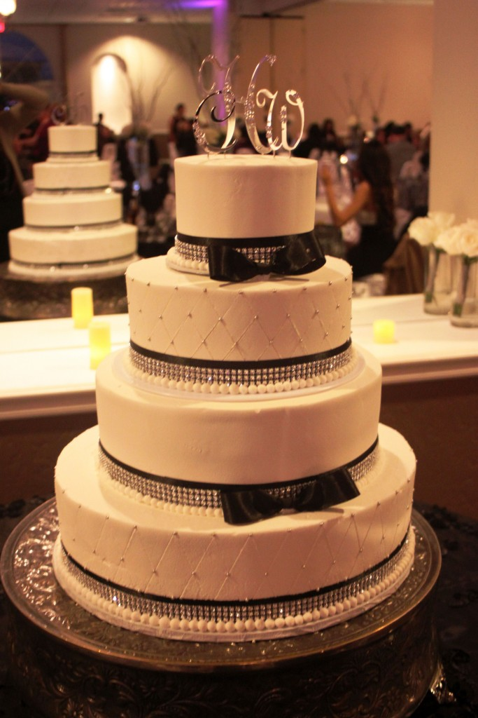 four tier black and white wedding cake with bows