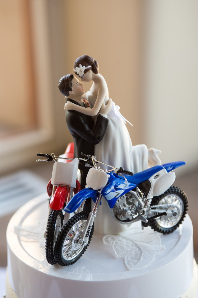 cake topper with bride and groom and motorcycles