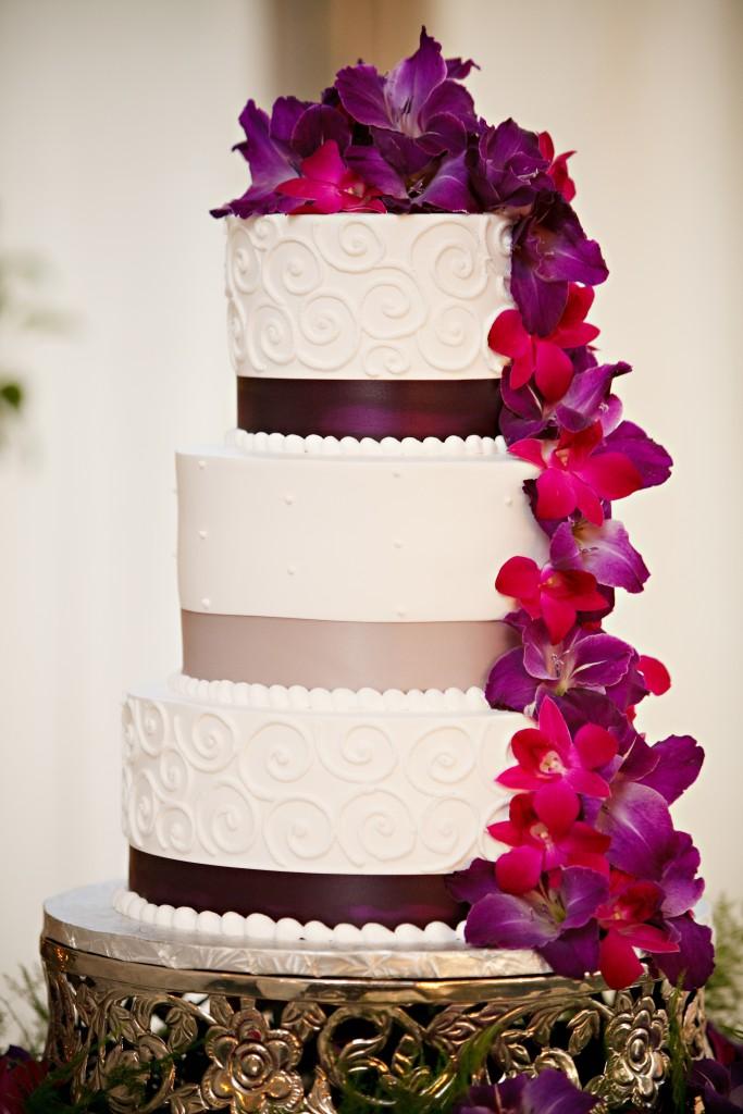 wedding cake with cascading fresh flowers