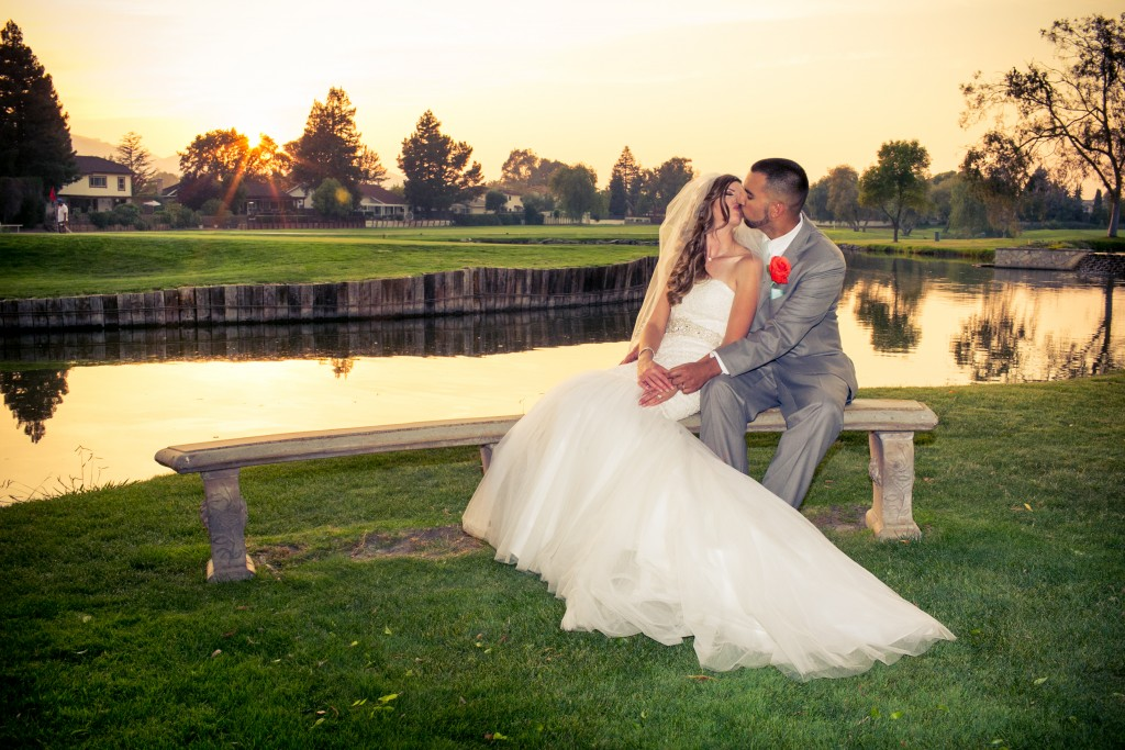 An intimate moment shared by the lake at San Ramon by Wedgewood Weddings