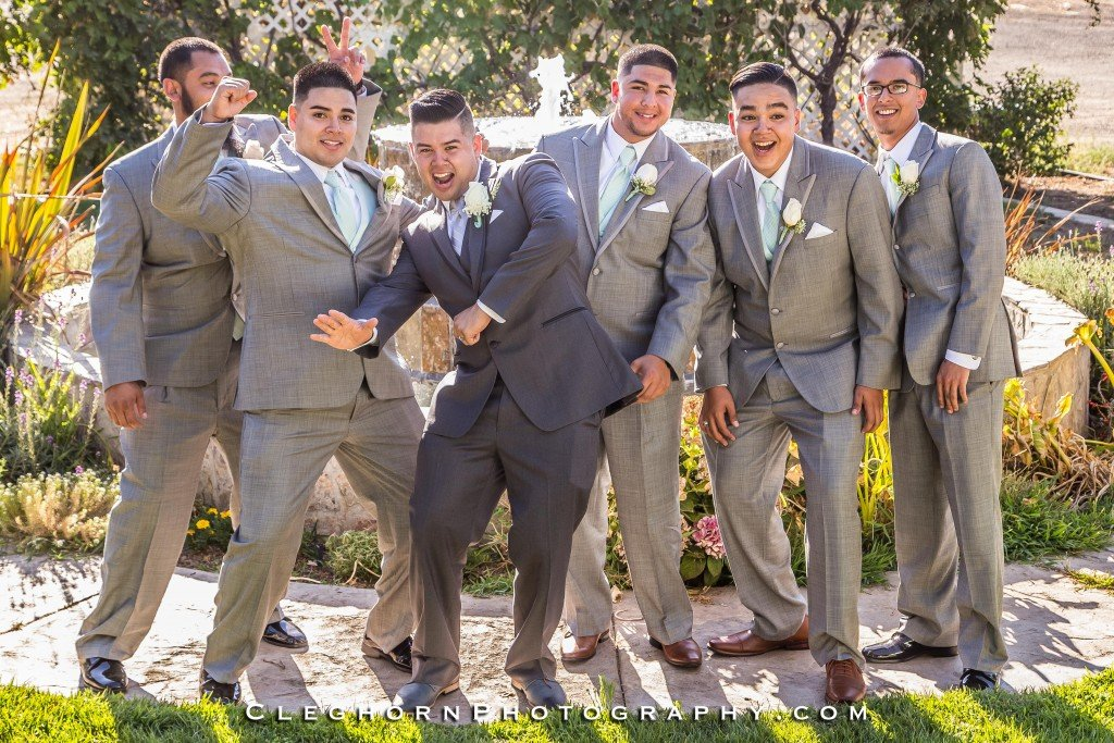 groom and groomsmen posing together