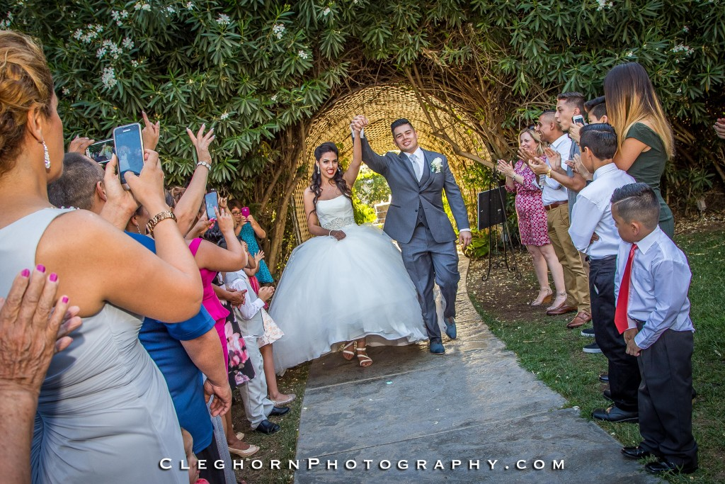 happy The Orchard by Wedgewood Weddings bride and groom walking down aisle together