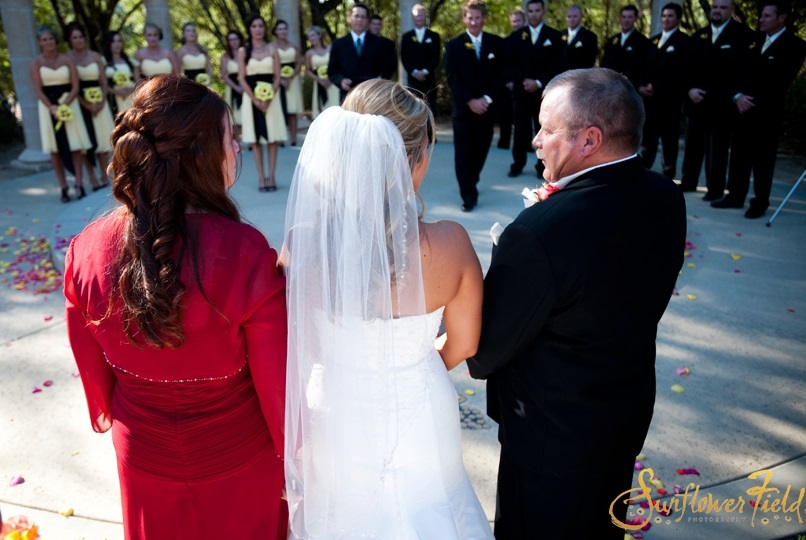 mom and dad give away bride at Wedgewood Weddings