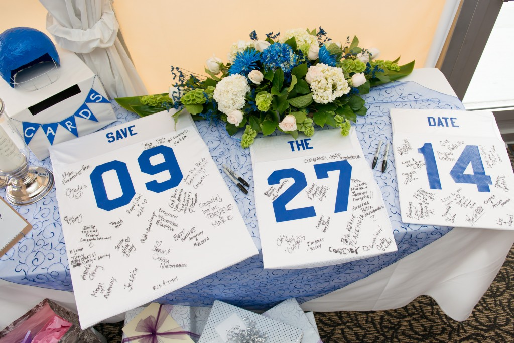 sports themed wedding gift table and wedding guest book