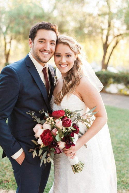 bride and groom photo with gorgeous wedding bouquet