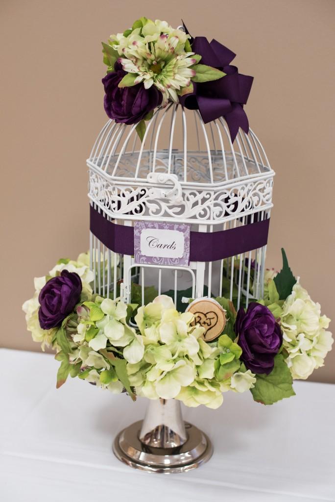 purple wedding color scheme bird cage centerpiece
