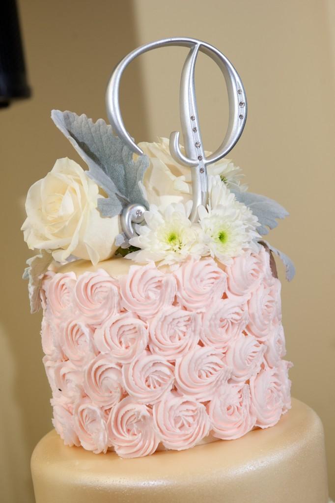 beautiful silver initial wedding cake topper