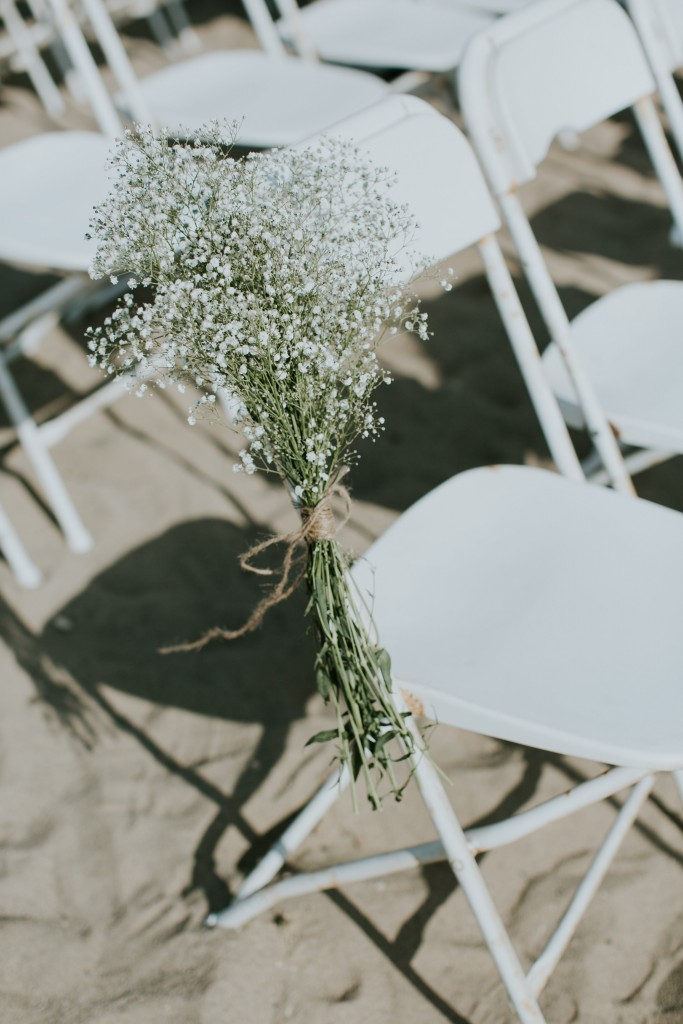 beach wedding baby's breath ceremony chair décor in sand