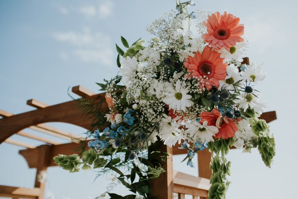 ventura california beach wedding ceremony floral arch