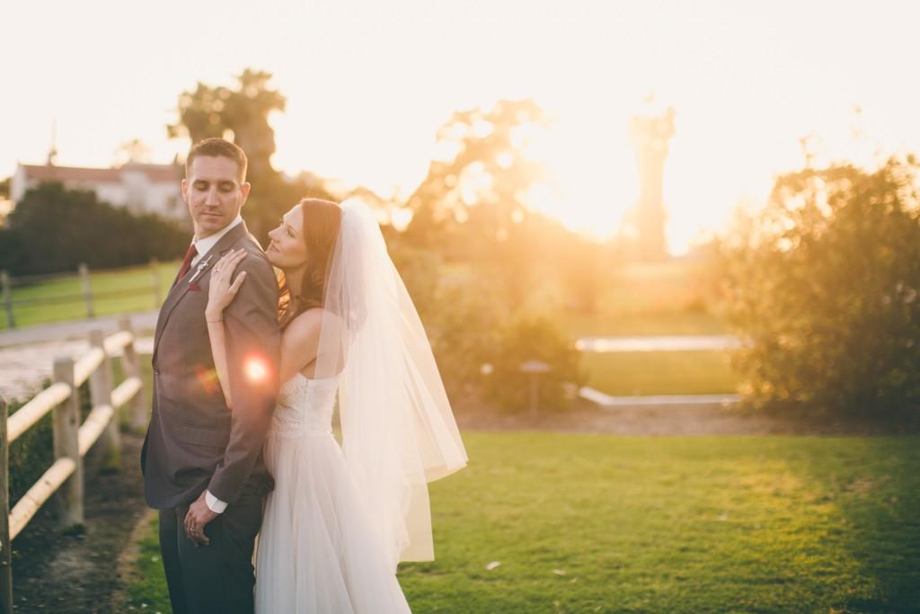 bride and groom hugging golden hour sunset