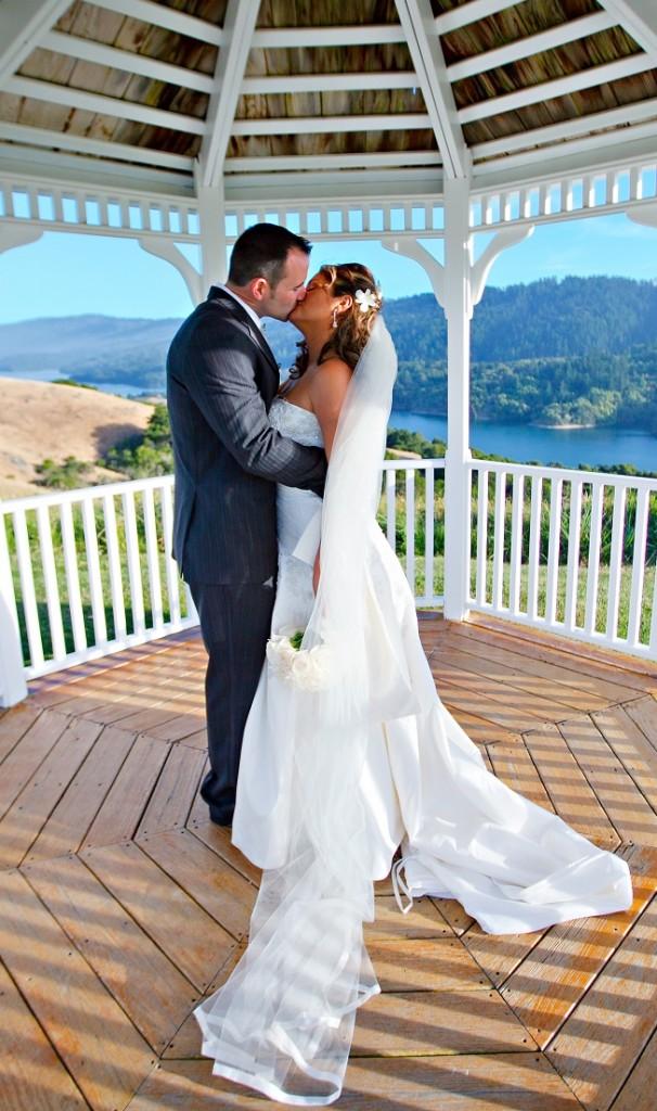 bride and groom gazebo kiss