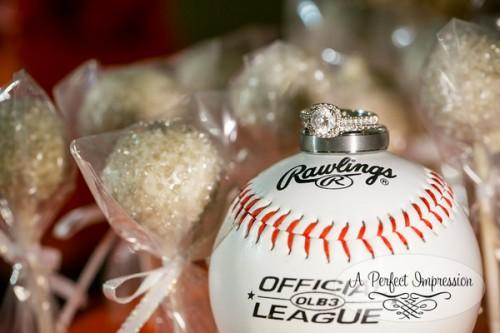 baseball sports themed wedding with rings on baseball