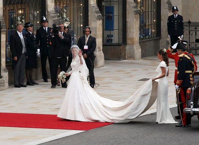 princess kate in her wedding dress walking into her royal wedding