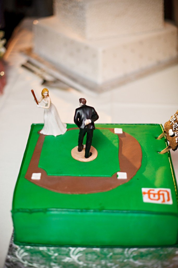 sports themed wedding cake with bride and groom playing baseball