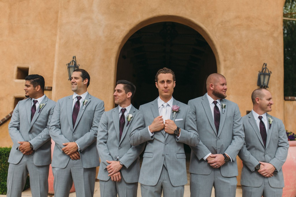 groom standing with groomsmen