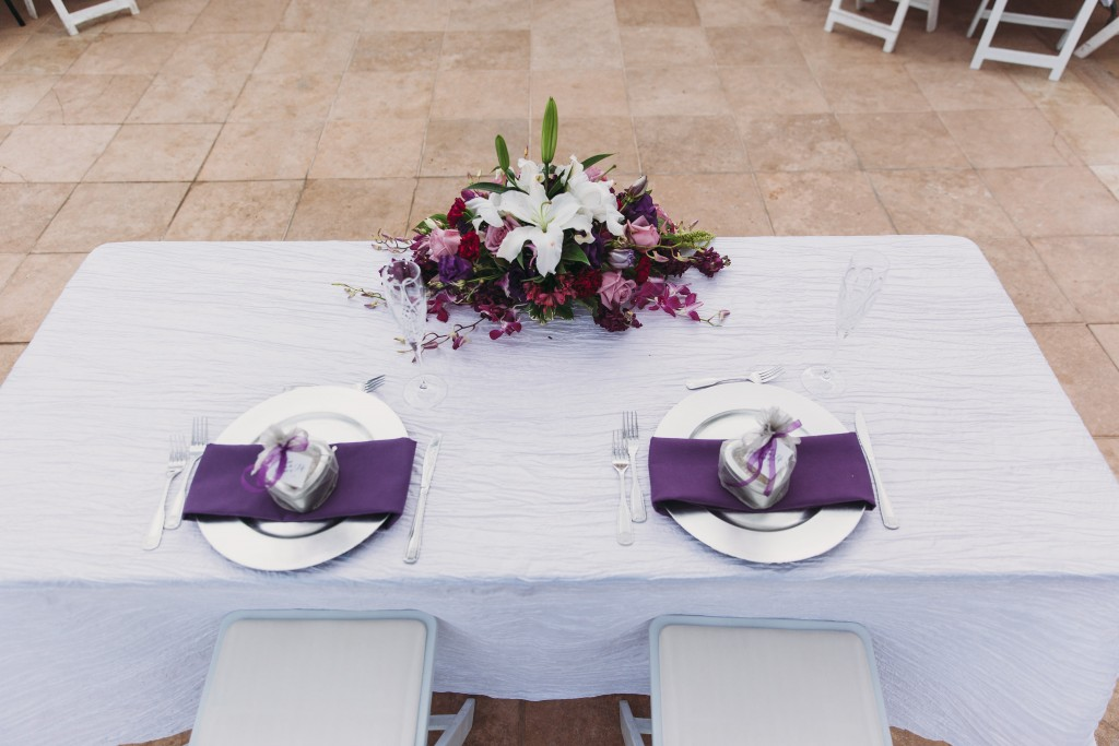 wedding table arrangement purple and floral centerpiece