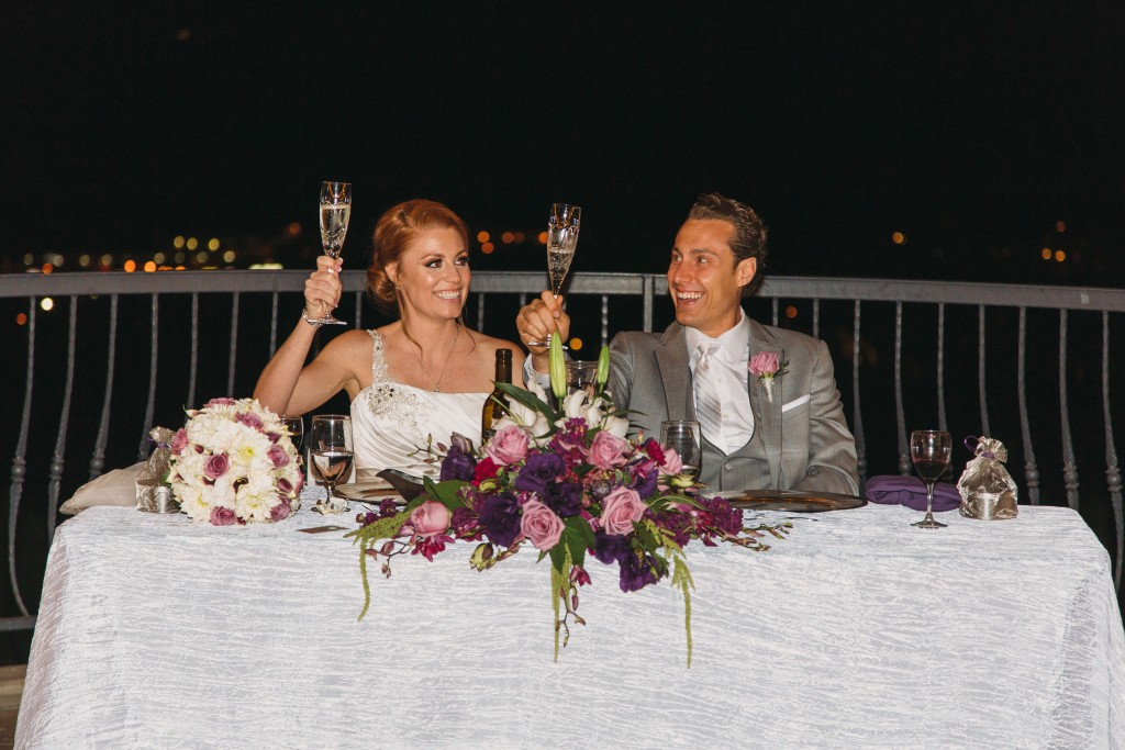bride and groom happily toasting
