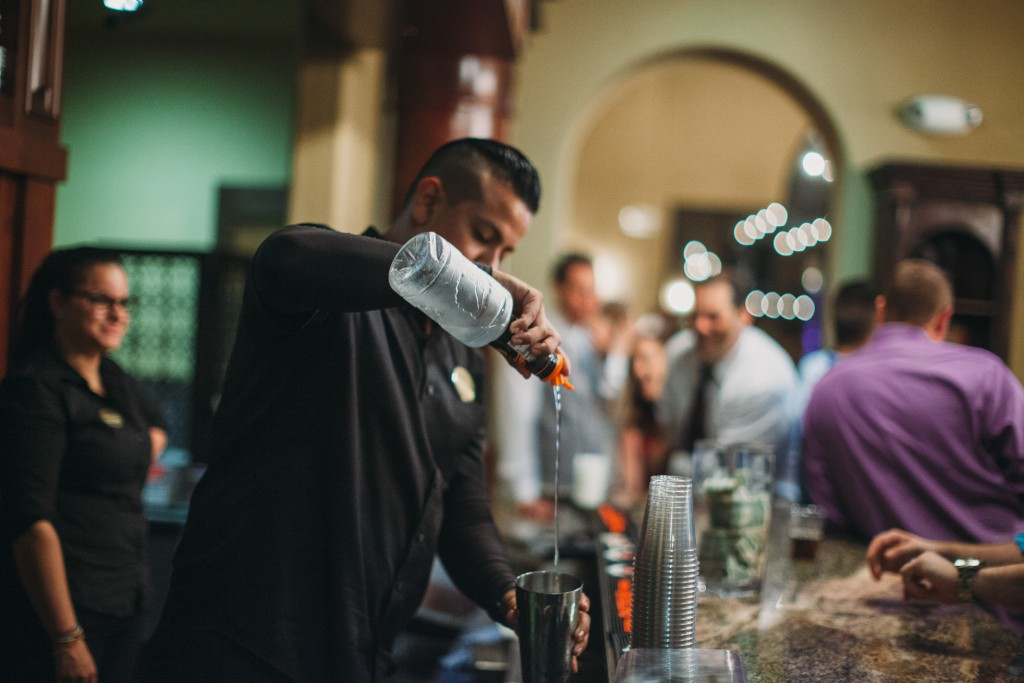 wedding bartender pouring liquor