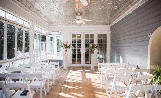 Intimate indoor ceremony in the Veranda.