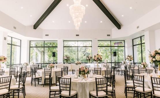 Vaulted ceilings, a crystal chandelier, and floor-to-ceiling windows - University Club - Irvine, California - Orange County - Wedgewood Weddings