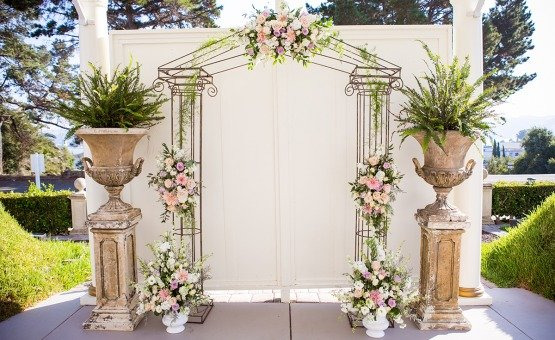 Ceremony arch with decorative floral - Jefferson Street Mansion - Benicia, California - Solano County - Wedgewood Weddings