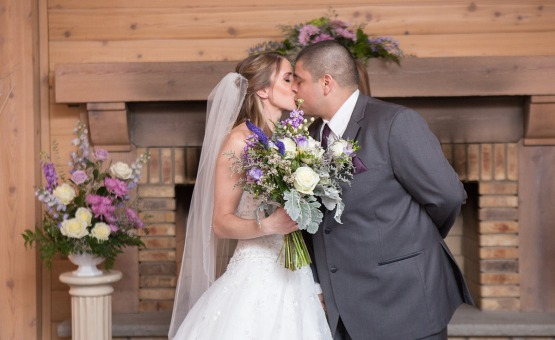 Kissing by the fire - North Shore - Wadsworth, Illinois - Lake County - Wedgewood Weddings