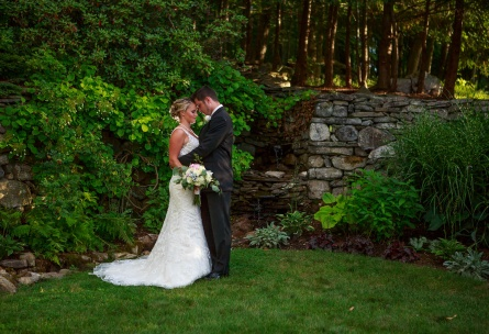 Romantic embrace between bride and groom - Granite Rose - Hampstead, New Hampshire - Rockingham County - Wedgewood Weddings