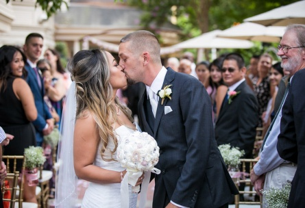 Bride and groom at their wedding ceremony - Sterling Hotel - Sacramento, California - Sacramento County - Wedgewood Weddings