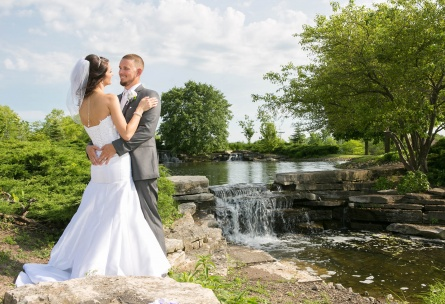 Bride and groom by waterfalll - North Shore - Wadsworth, Illinois - Lake County - Wedgewood Weddings