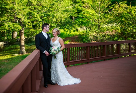 Bride and groom on wrap-around deck - Granite Rose - Hampstead, New Hampshire - Rockingham County - Wedgewood Weddings