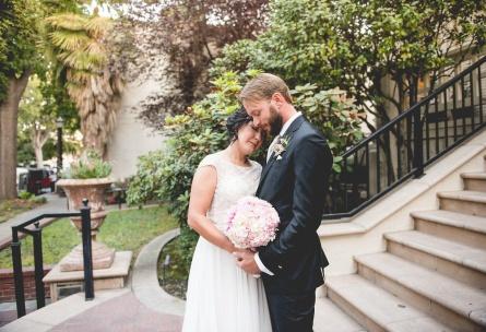 Romance between bride and groom - Sterling Hotel - Sacramento, California - Sacramento County - Wedgewood Weddings