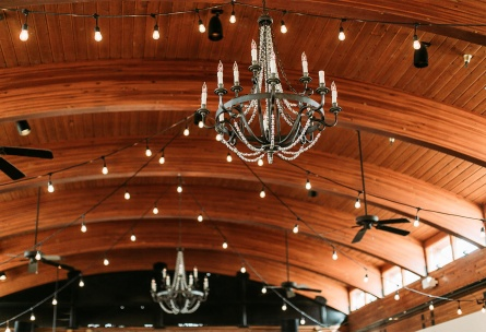 Chandeliers and market lights create romantic lighting in the ballroom.