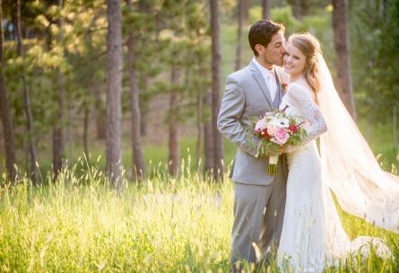 Groom Kissing Bride on the Cheek - Black Forest - Colorado Springs, Colorado - El Paso County - Wedgewood Weddings
