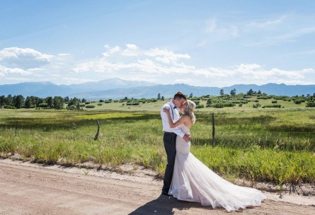 Couple Kissing with Mountains in Background - Black Forest - Colorado Springs, Colorado - El Paso County - Wedgewood Weddings