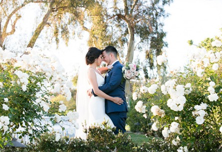 Romantic couple with white roses - San Clemente - San Clemente, California - Orange County - Wedgewood Weddings