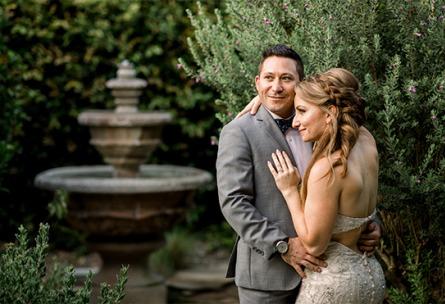 Couple by a fountain  University Club - Irvine, California - Orange County - Wedgewood Weddings