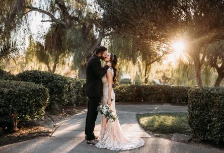 Romantic couple by sunlit trees - Menifee Lakes - Menifee, California - Riverside County - Wedgewood Weddings