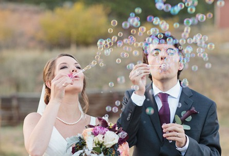 Couple Blowing Bubbles - Mountain View Ranch - Pine, Colorado - Jefferson County - Wedgewood Weddings