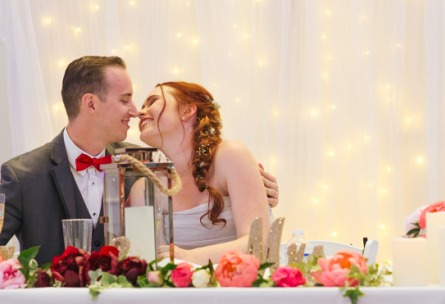 Couple smiling during speeches - Union Brick - Roseville, California, Placer County - Wedgewood Weddings