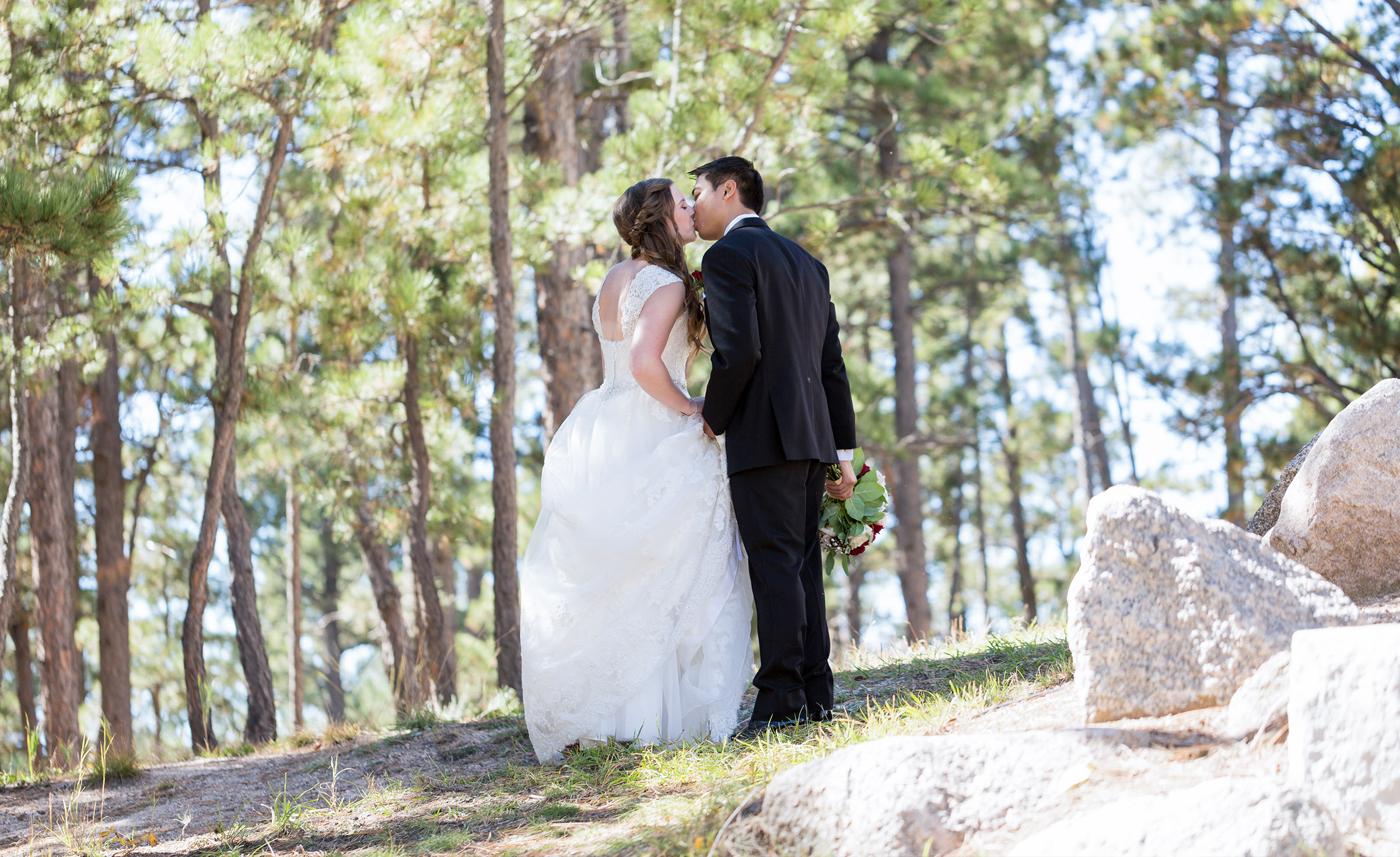 Romantic kiss in the woods - Black Forest - Colorado Springs, Colorado - El Paso County - Wedgewood Weddings