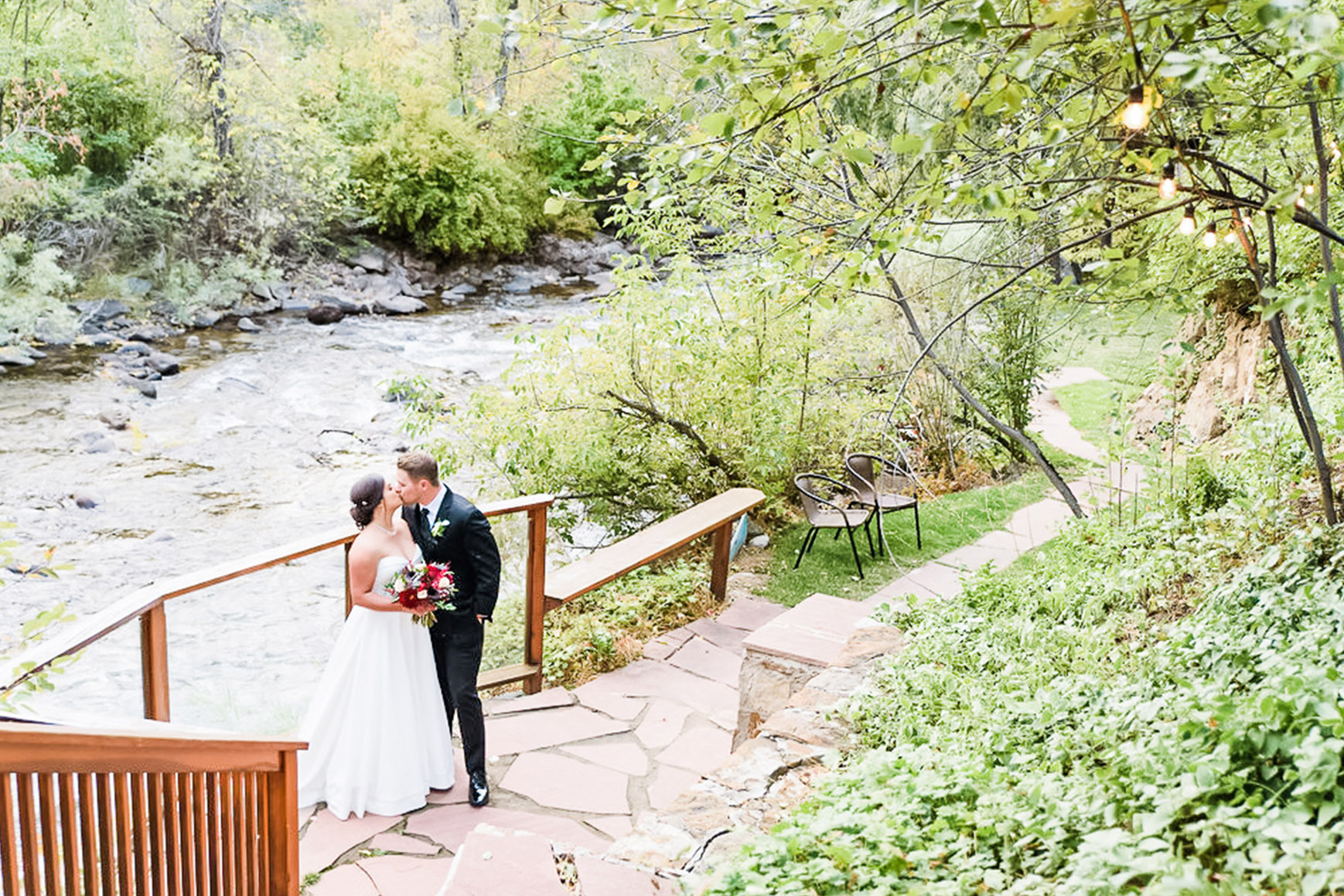 Couple Kissing by Creek - Boulder Creek - Boulder, Colorado - Boulder County - Wedgewood Weddings
