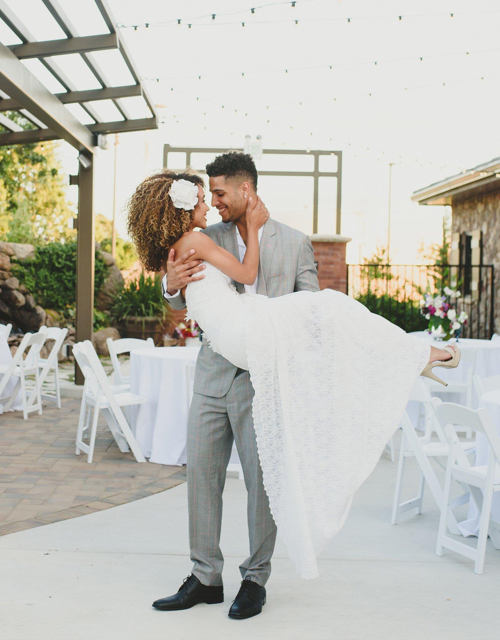 Groom carrying bride - Evergreen Springs - Elk Grove, California - Sacramento County - Wedgewood Weddings
