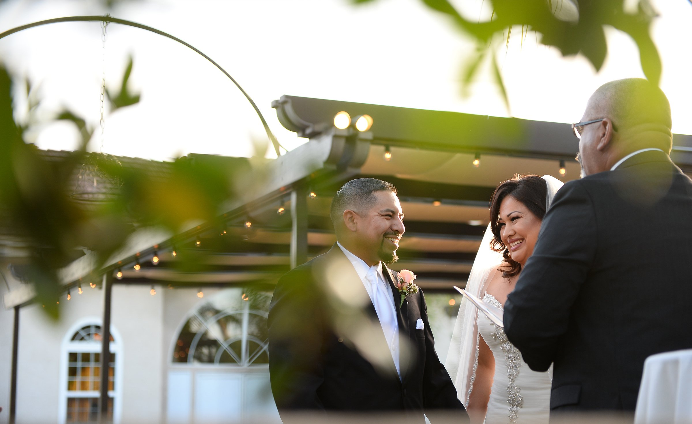 Romantic lighting during a golden hour wedding ceremony - Fresno - Fresno, California - Frenso County - Wedgewood Weddngs