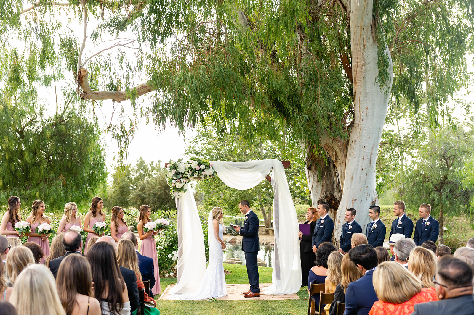 personalized vows at outdoor wedding ceremony