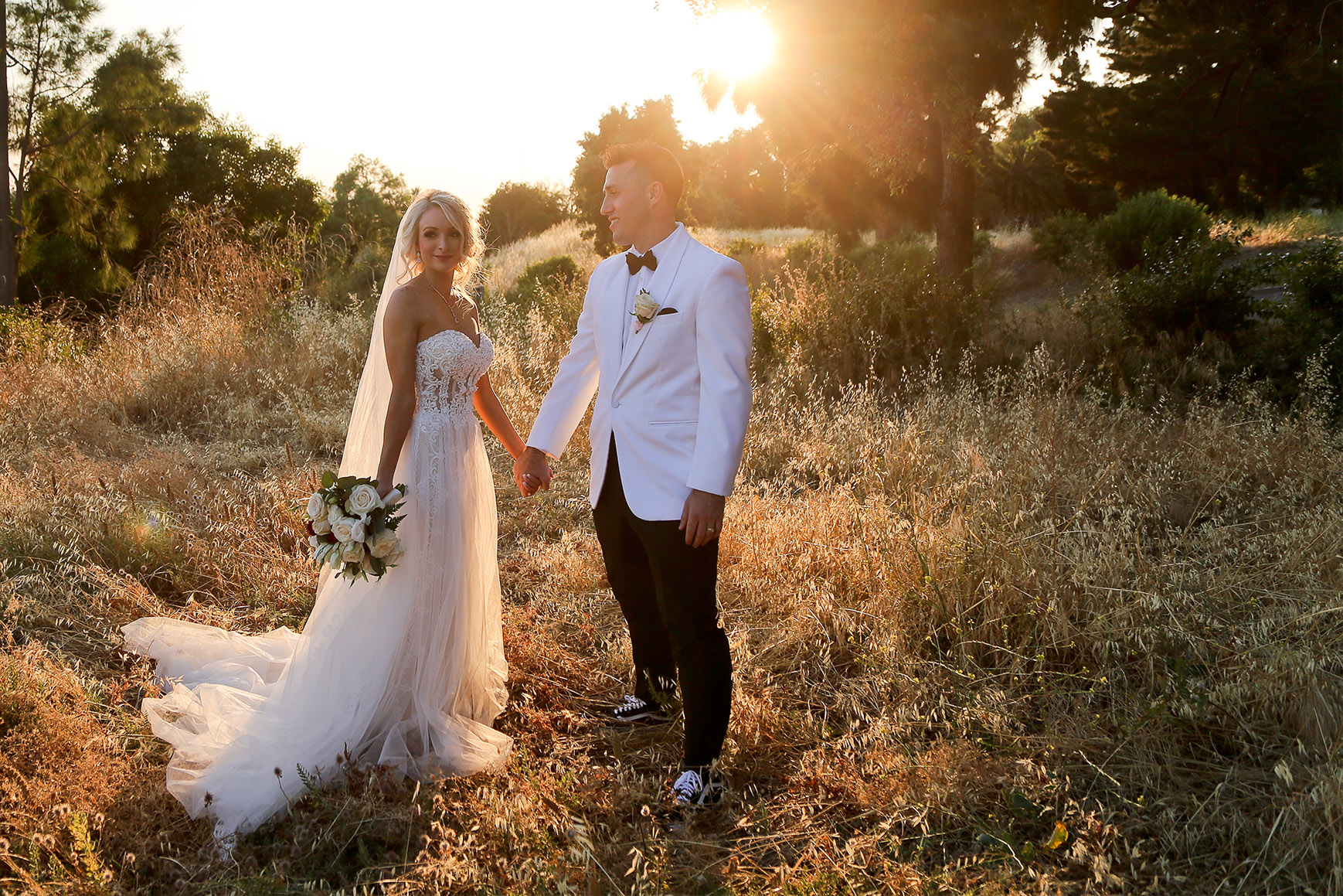 Bride and groom pose in a field - Jefferson Street Mansion - Benicia, California - Solano County - Wedgewood Weddings