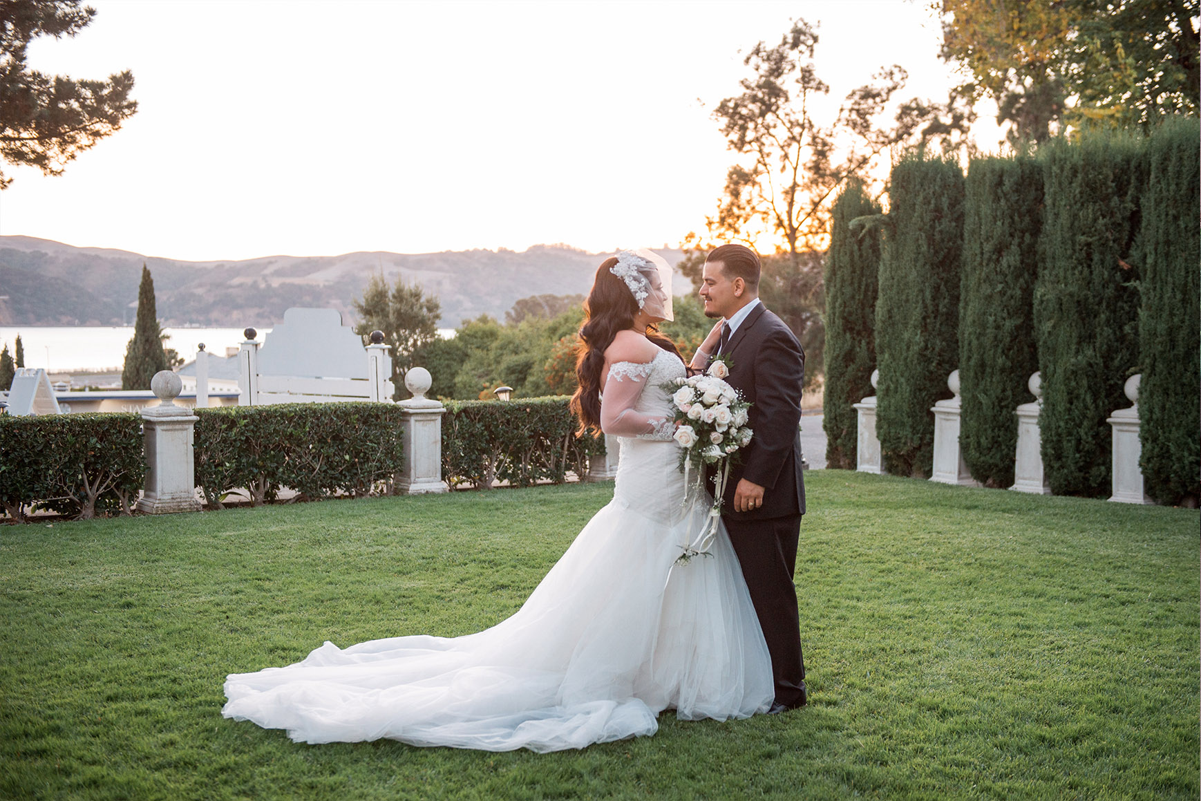 Bride and groom pose in the perfectly manicured grounds - Jefferson Street Mansion - Benicia, California - Solano County - Wedgewood Weddings