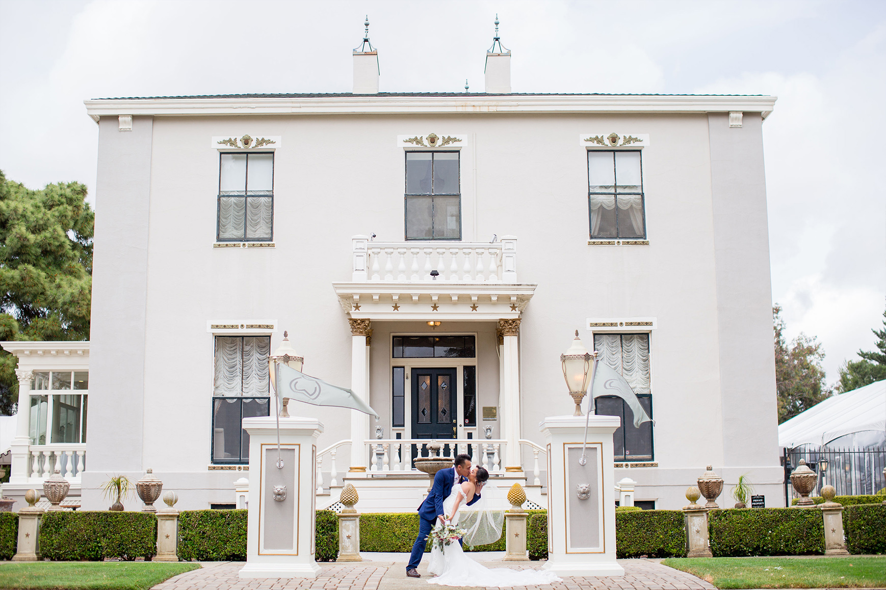 Kissing couple in front of the mansion - Jefferson Street Mansion - Benicia, California - Solano County - Wedgewood Weddings