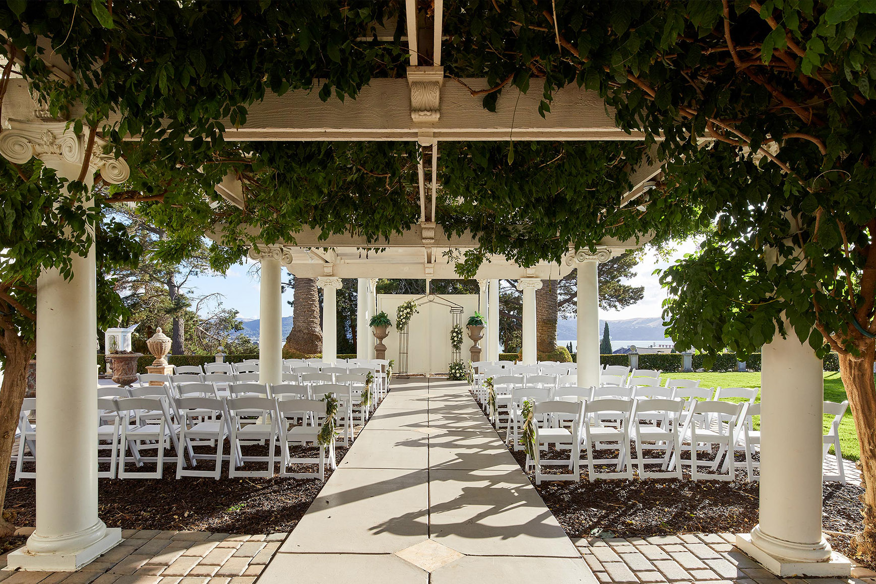 Lush ceremony site - Jefferson Street Mansion - Benicia, California - Solano County - Wedgewood Weddings