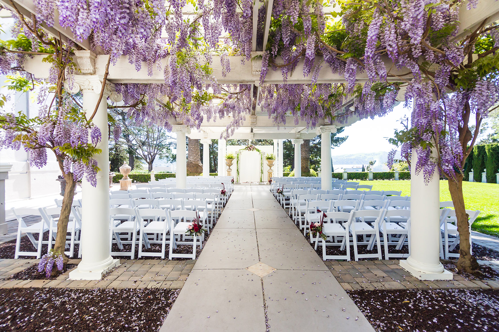 Ceremony site with blooming wisteria - Jefferson Street Mansion - Benicia, California - Solano County - Wedgewood Weddings